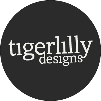tigerlilly designs logo dark in a dark circle